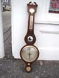 click to view detailed description of A 19th century mahogany veneered banjo barometer by Anthony Pozzi circa 1830-1850